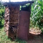 The Water Project: Musiachi Community -  Mud Latrine With Door