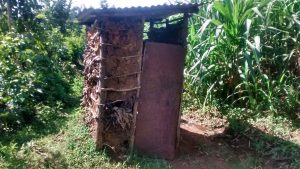 The Water Project:  Mud Latrine With Door
