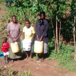 The Water Project: Musiachi Community -  Women And Girls Stand With Water Containers