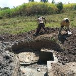 The Water Project: Futsi Fuvili Community, Simeon Shimaka Spring -  Clearing Ground Around Spring