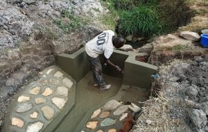 The Water Project:  Paving Cement Walls