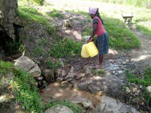 The Water Project:  A Community Member Gets Fready To Fetch Water