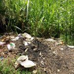 The Water Project: Indete Community, Udi Spring -  Dumpsite At The Community