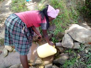 The Water Project:  Filling Jerrycan At Source