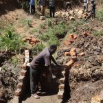 The Water Project: Elukuto Community -  Laying Bricks For Protection
