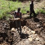 The Water Project: Elukuto Community, Isa Spring -  Placing Stones For Spring