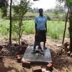 The Water Project: Elukuto Community -  Standing With New Latrine Platform