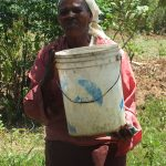 The Water Project: Vilongo Community -  Vilongo Woman Carrying Water