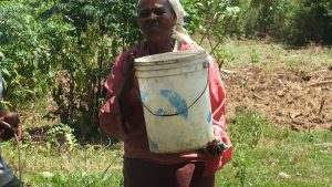 The Water Project:  Vilongo Woman Carrying Water