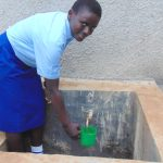 The Water Project: St. Mary's Girl's High School -  Collecting Water From New Tank