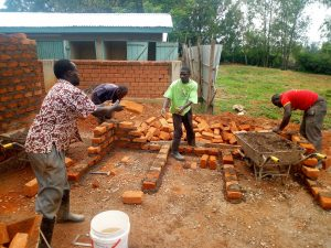 The Water Project:  Laying Bricks For The Latrines