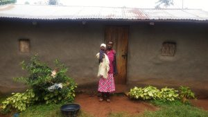 The Water Project:  Mama Karani Outside Her House