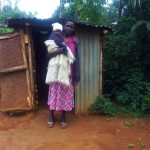 The Water Project: Emulakha Community, Alukoye Spring -  Mama Karani Outside Her Latrine