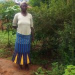 The Water Project: Emulakha Community -  Mrs Caroli Poses Beside The Hole In The Ground That Acts As Her Latrine