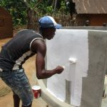 The Water Project: Kigbal Community -  Painting The New Well