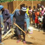 The Water Project: Kigbal Community -  Ground Breaking