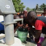 The Water Project: Tholmosor Community, Alpha Dabola Road -  Drinking The Safe Water