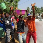 The Water Project: Tholmosor Community, Alpha Dabola Road -  Happy