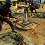 The Water Project: Tholmosor Community, Alpha Dabola Road -  Laying Concrete For Well Base