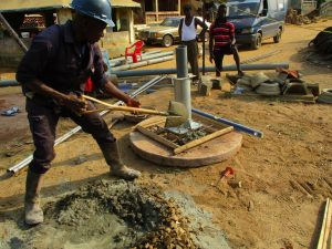 The Water Project:  Laying Concrete For Well Base