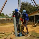 The Water Project: Tholmosor Community, Alpha Dabola Road -  Lining Up The Drilling Rod