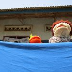 The Water Project: Tholmosor Community, Alpha Dabola Road -  Puppet Performance During Trainng
