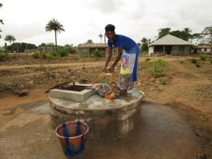 The Water Project:  Pulling Bucket Of Water Up Well
