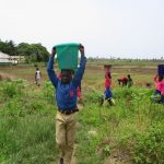 The Water Project: St. John RC Primary School -  Student Carrying Water