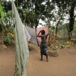 The Water Project: Molokoh Community, 720 Main Motor Road -  Woman Using Clothesline