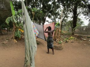 The Water Project:  Woman Using Clothesline