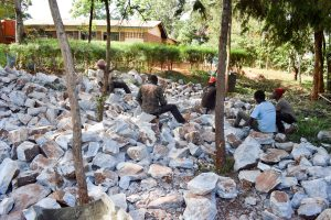 The Water Project:  Breaking Up Stones For Tank Construction