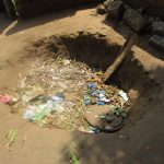 The Water Project: Modia Community, 4 Father Road -  Garbage Pit