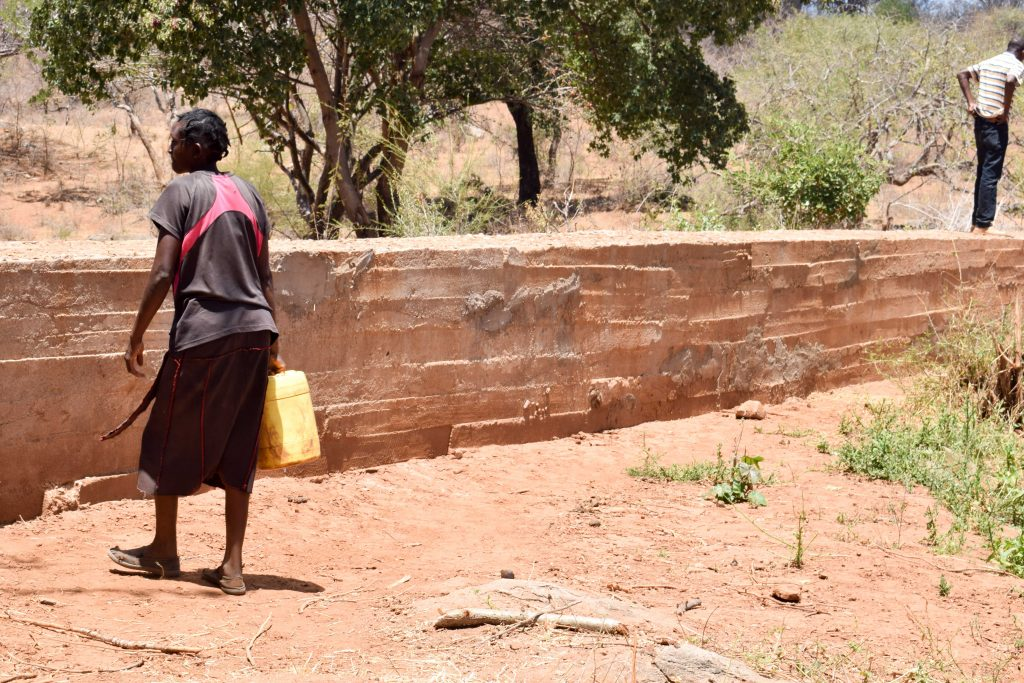 The Water Project : 2-kenya18179-carrying-water-home