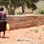 The Water Project: Katuluni Community C -  Carrying Water Home