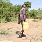 The Water Project: Kivani Community B -  Carrying Water