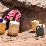 The Water Project: Utuneni Community -  Using Scoop Holes