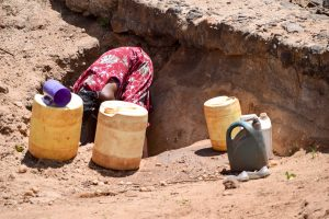 The Water Project:  Using Scoop Holes