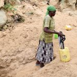 The Water Project: Mbau Community -  Carrying Water