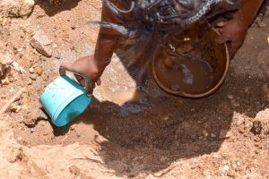 The Water Project:  Scooping Dirty Water