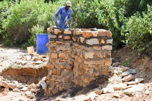 The Water Project:  Artisan Putting The Finishing Touches On The Well
