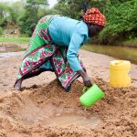 The Water Project: Kitandini Community A -  Fetching Water
