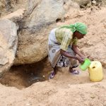 The Water Project: Mbau Community A -  Fetching Water