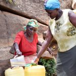 The Water Project: Utuneni Community C -  Sieving Dirt Out Of The Water