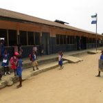 The Water Project: St. John RC Primary School -  Students Outside Classrooms
