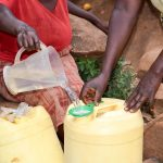 The Water Project: Uthunga Community A -  Sieving Dirt