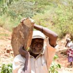 The Water Project: Mbuuni Community D -  Carrying A Stone For The Dam