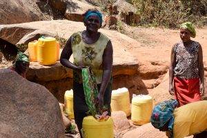 The Water Project:  Carrying Heavy Container