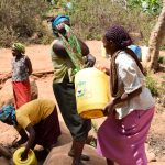 The Water Project: Utuneni Community A -  Carrying Heavy Water