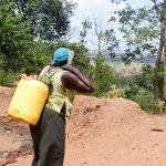The Water Project: Utuneni Community C -  Carrying Heavy Water