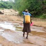 The Water Project: Kivandini Community -  Carrying Water